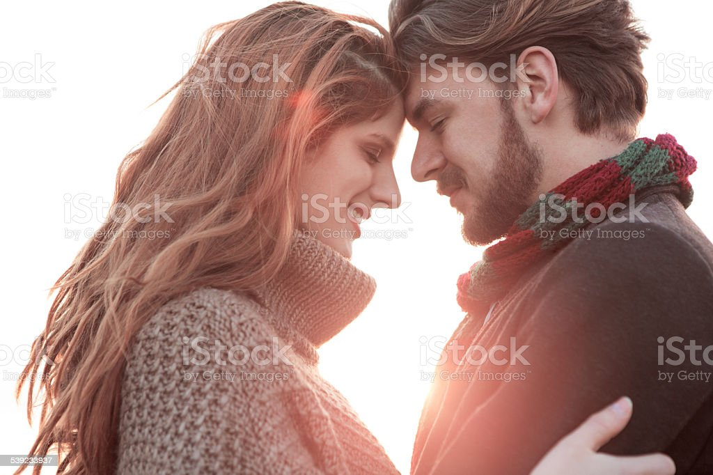 Couple outdoors at sunset. royalty-free stock photo