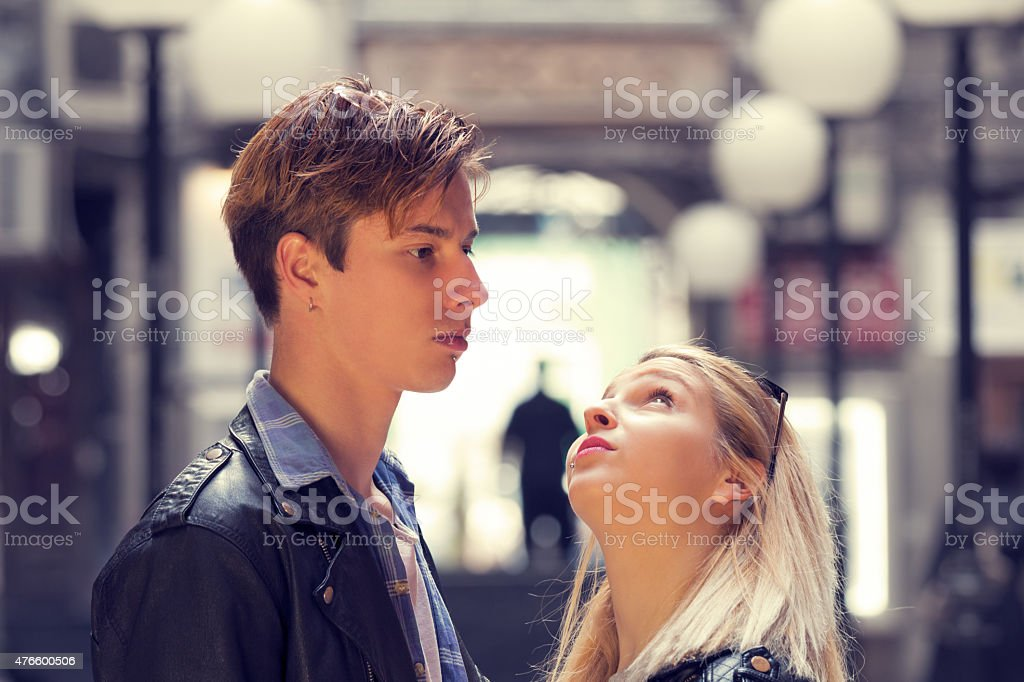 Couple outdoors in a urban surroundings. stock photo