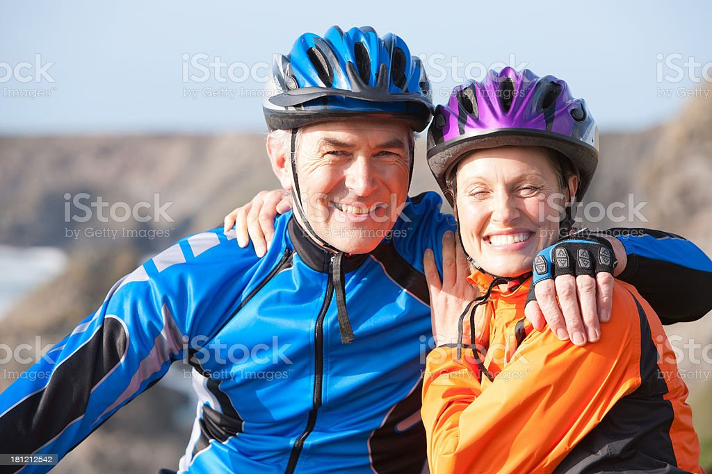 couple outdoors on bicycle embracing stock photo