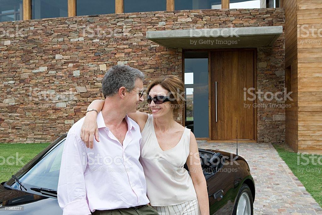 Couple outside a house royalty-free stock photo