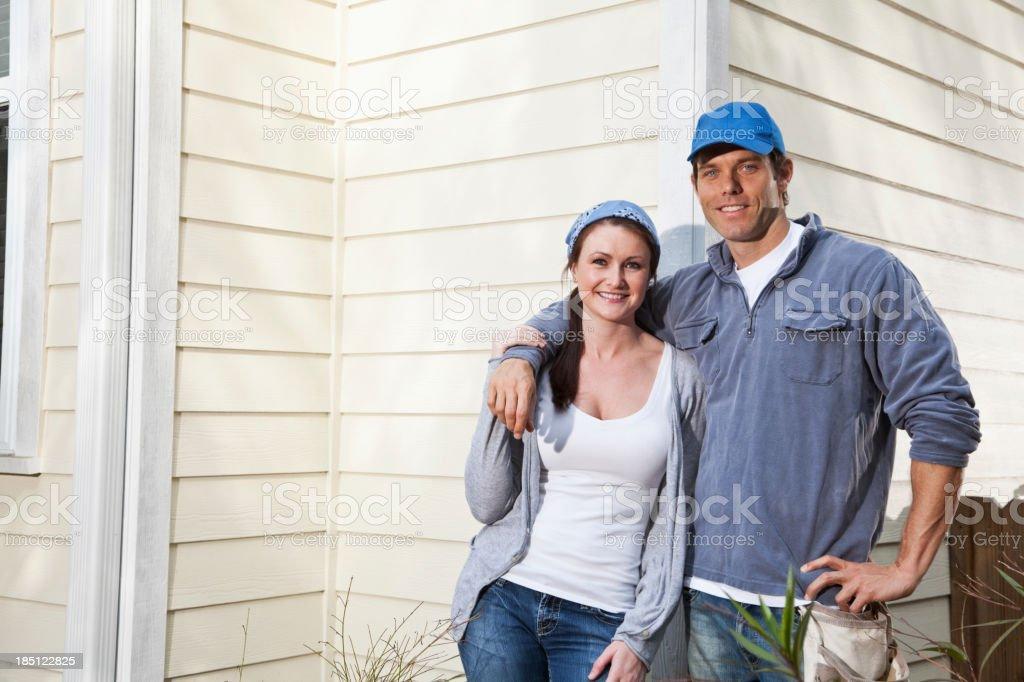Couple outside house stock photo