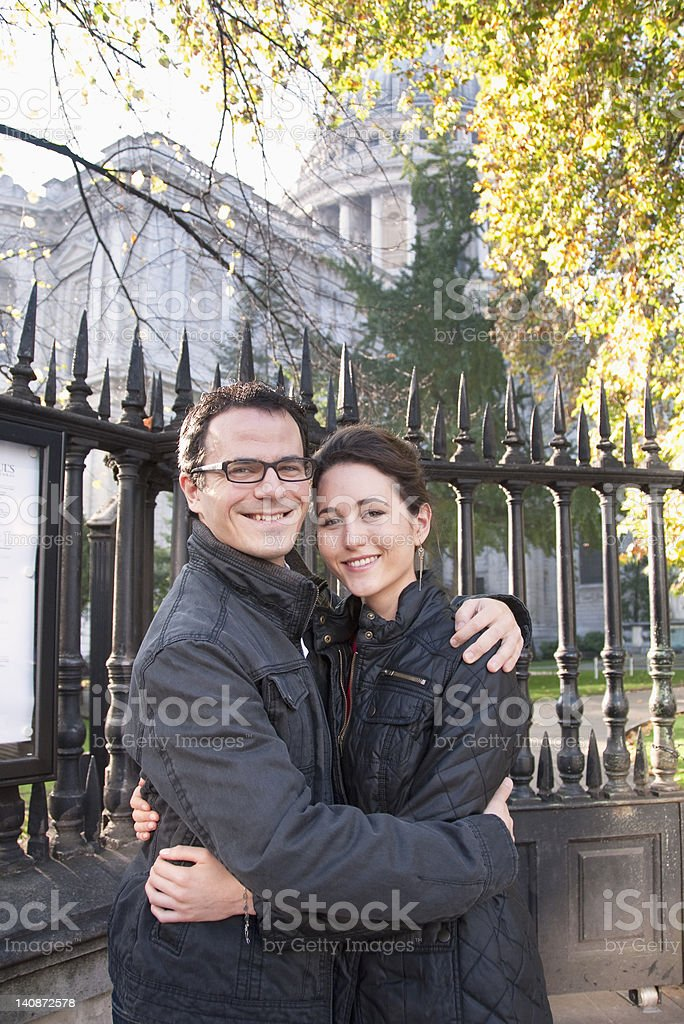 Couple outside St Pauls Cathedral royalty-free stock photo