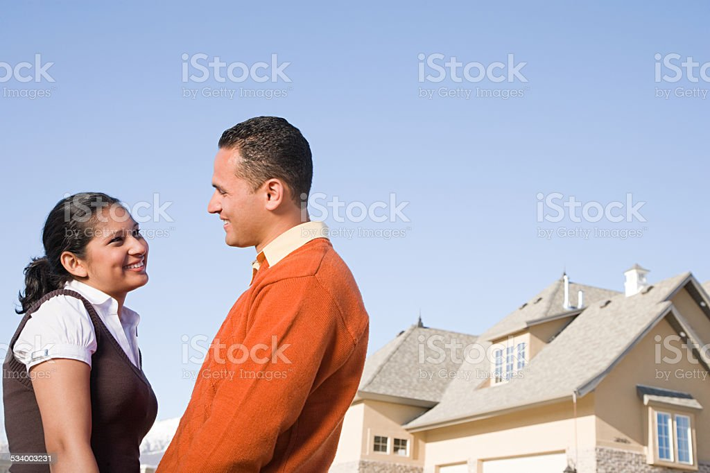 Couple outside their new home stock photo