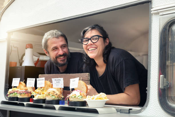 Couple owners food truck Couple owners food truck female sandwich stock pictures, royalty-free photos & images