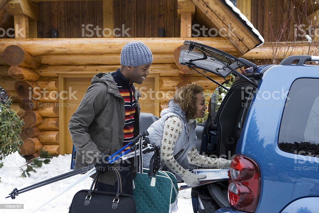 Couple packing car boot stock photo