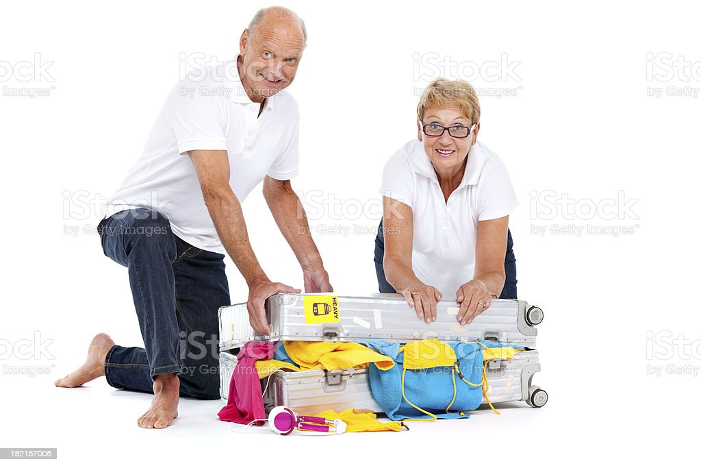 couple packing suitcase royalty-free stock photo