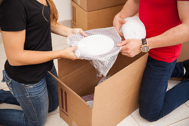 Couple packing together stock photo
