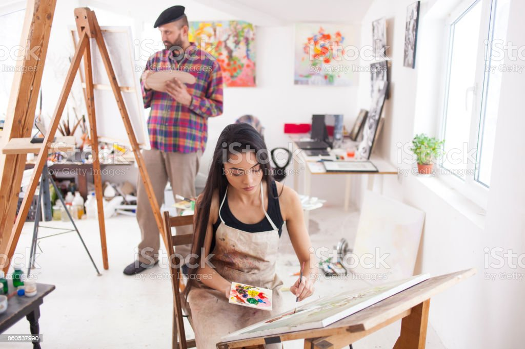 Couple painters drawing in workshop stock photo