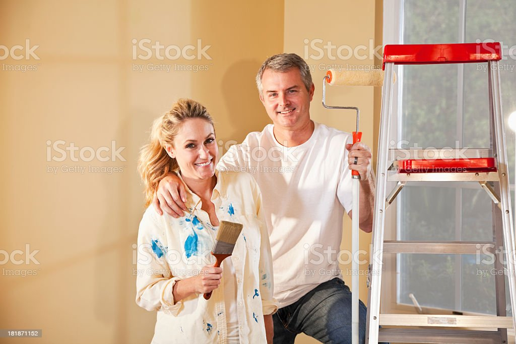 Couple painting home interior stock photo