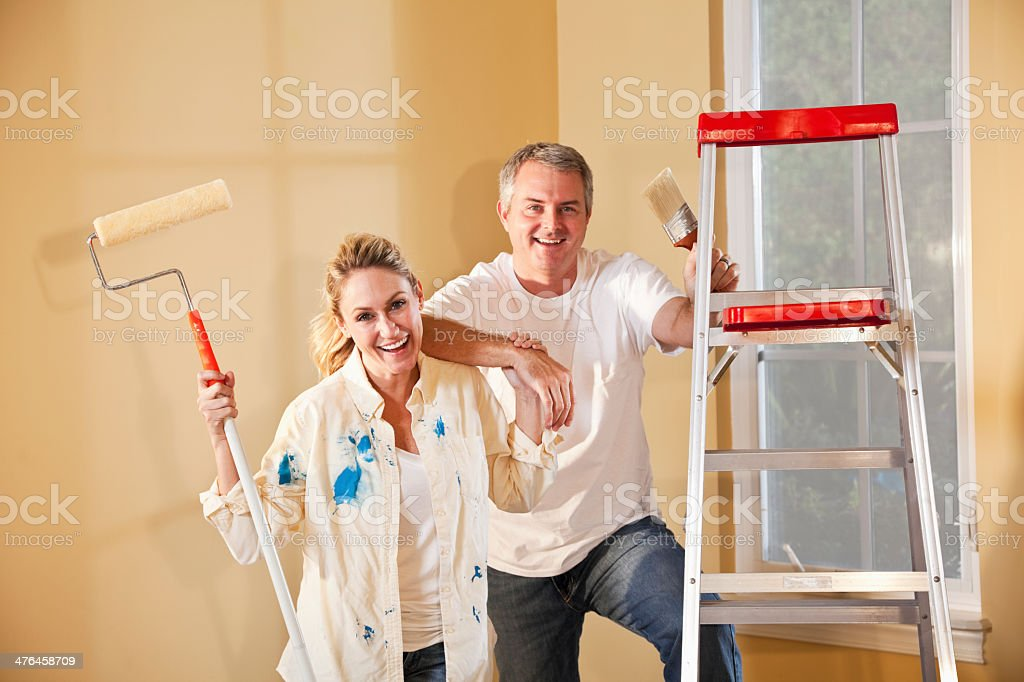 Couple painting home interior royalty-free stock photo