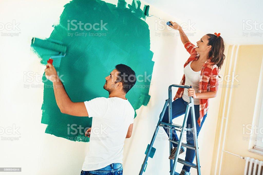 Couple painting walls. stock photo