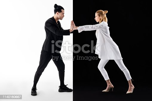 istock Couple participating in black and white photo session 1140180667