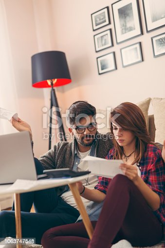istock Couple paying taxes 1063747548