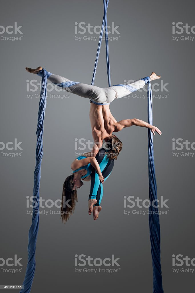couple performing aerial silk dance stock photo