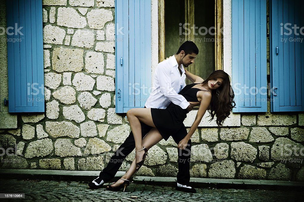 Couple performing passionate tango stock photo