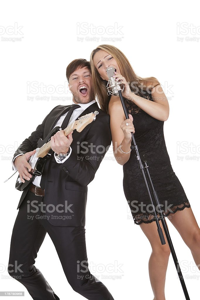Couple performs duet to everybody stock photo