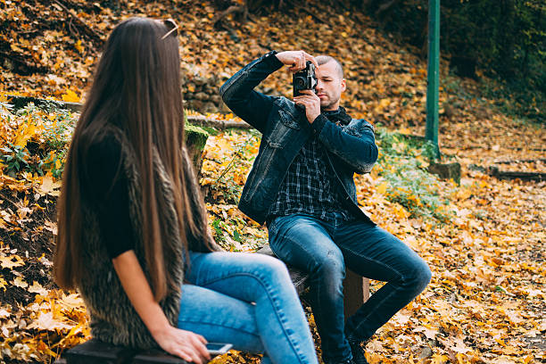 Couple photographing each other stock photo
