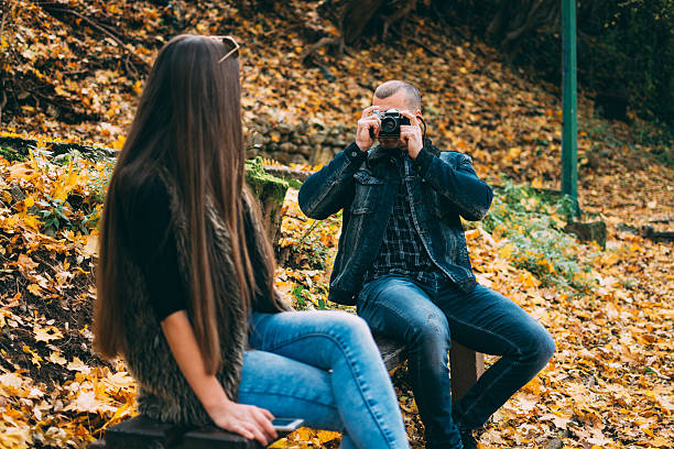 Couple Photogrpahing each other stock photo