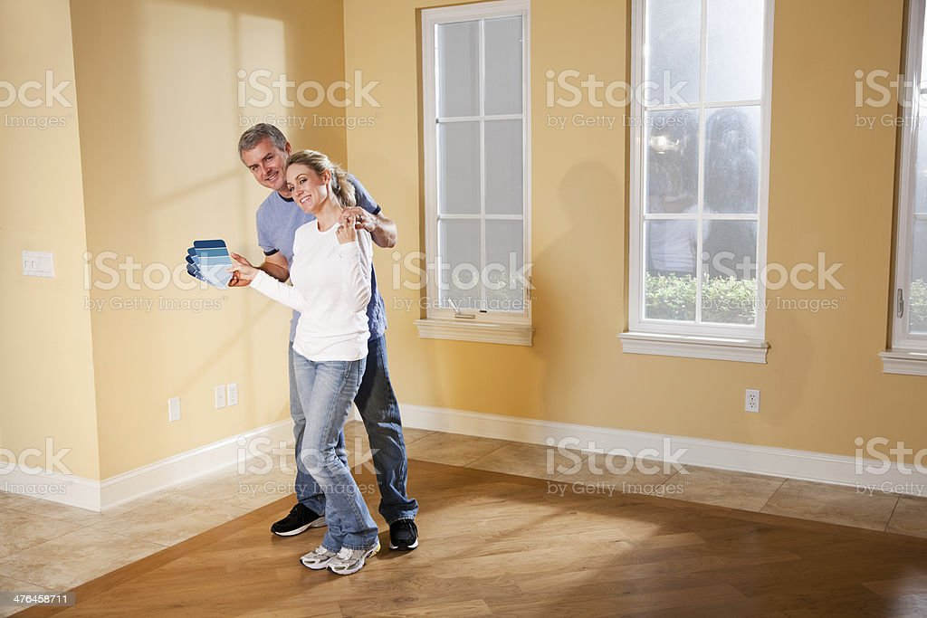 Couple picking new paint color royalty-free stock photo