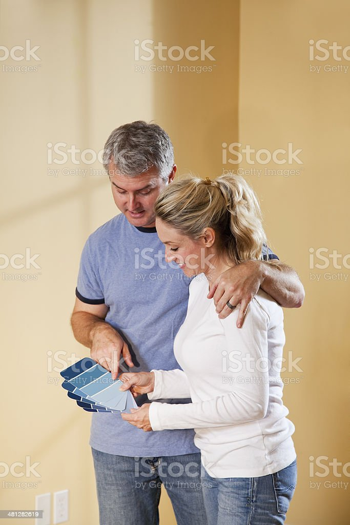 Couple picking new paint color stock photo
