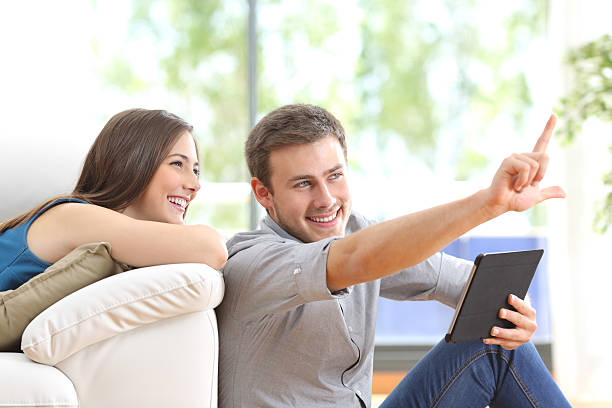 couple planning decoration at home - sofa online kaufen stock-fotos und bilder