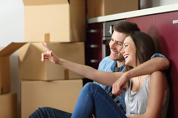 couple planning relocation in the kitchen - tenant stock photos and pictures
