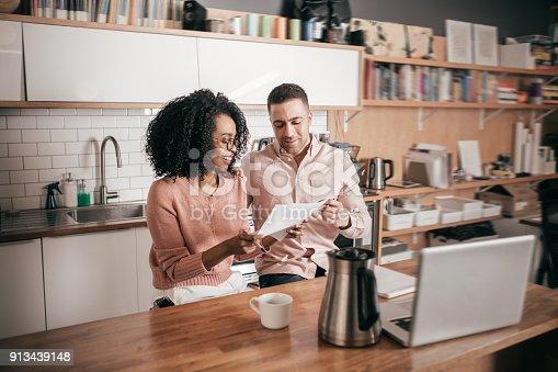 istock Couple planning their finances on the kitchen 913439148