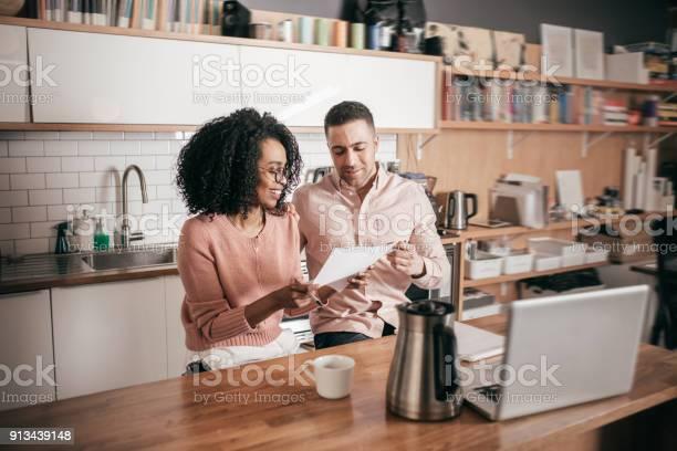Couple planning their finances on the kitchen picture id913439148?b=1&k=6&m=913439148&s=612x612&h=peon5lnupmfaj s80dmqicnqnn9q jfo8czuuc6vxwi=