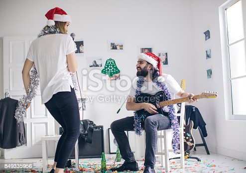 849362192 istock photo Couple playing a christmas song 849335956