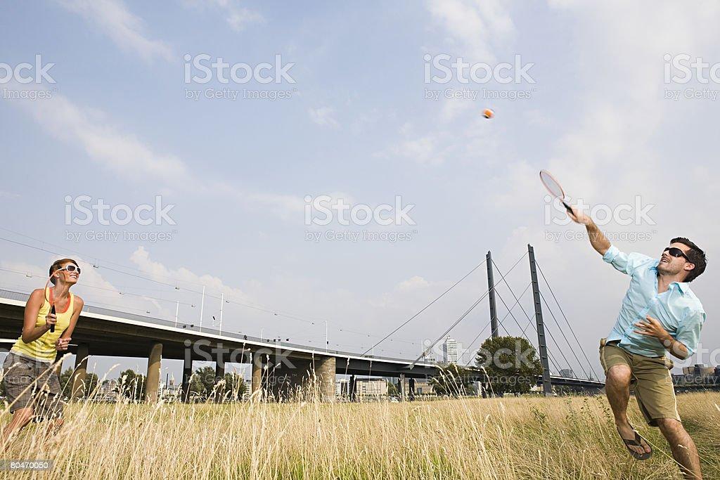 Couple playing badminton 免版稅 stock photo
