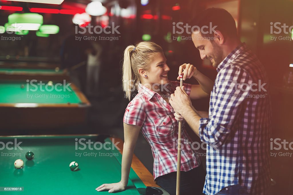 Couple playing billiards together - foto de acervo