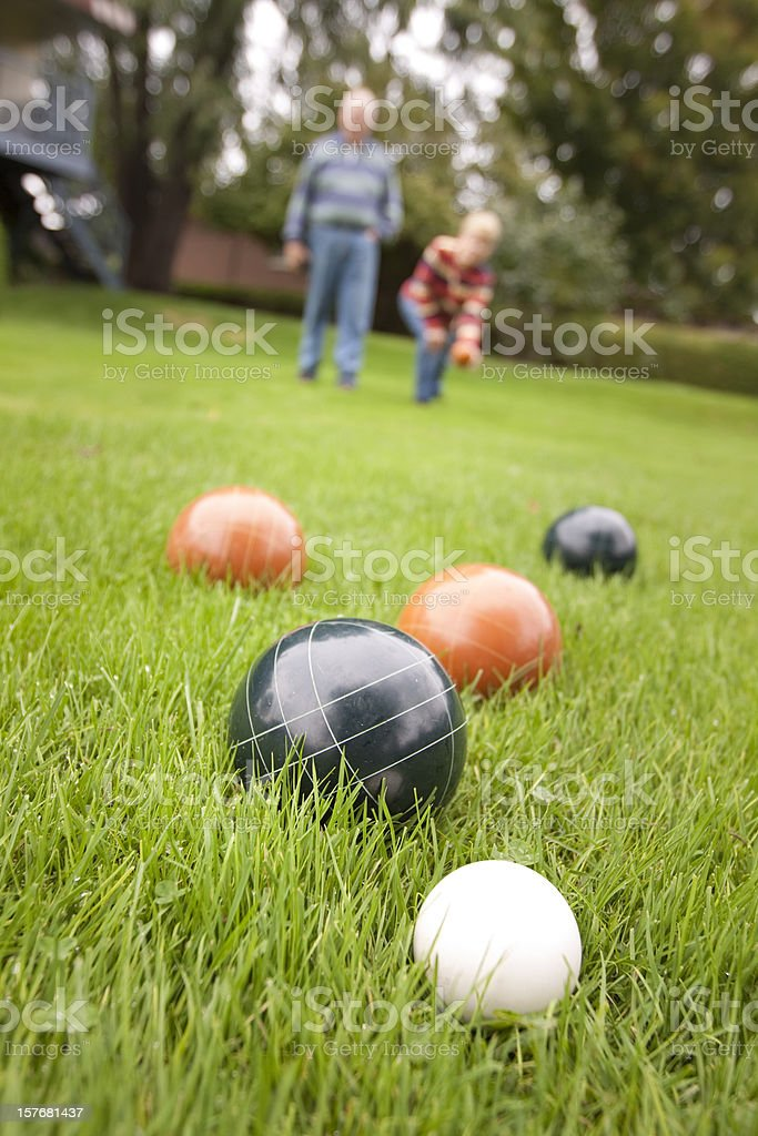 Couple playing bocce ball stock photo