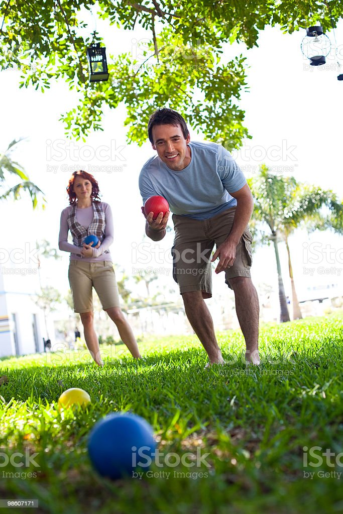 Couple playing bocce ball royalty-free stock photo