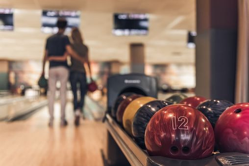 istock Couple playing bowling 856749966