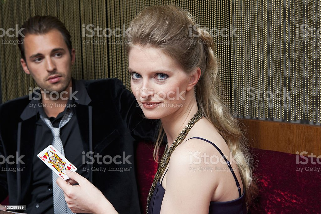 Couple playing cards in bar stock photo
