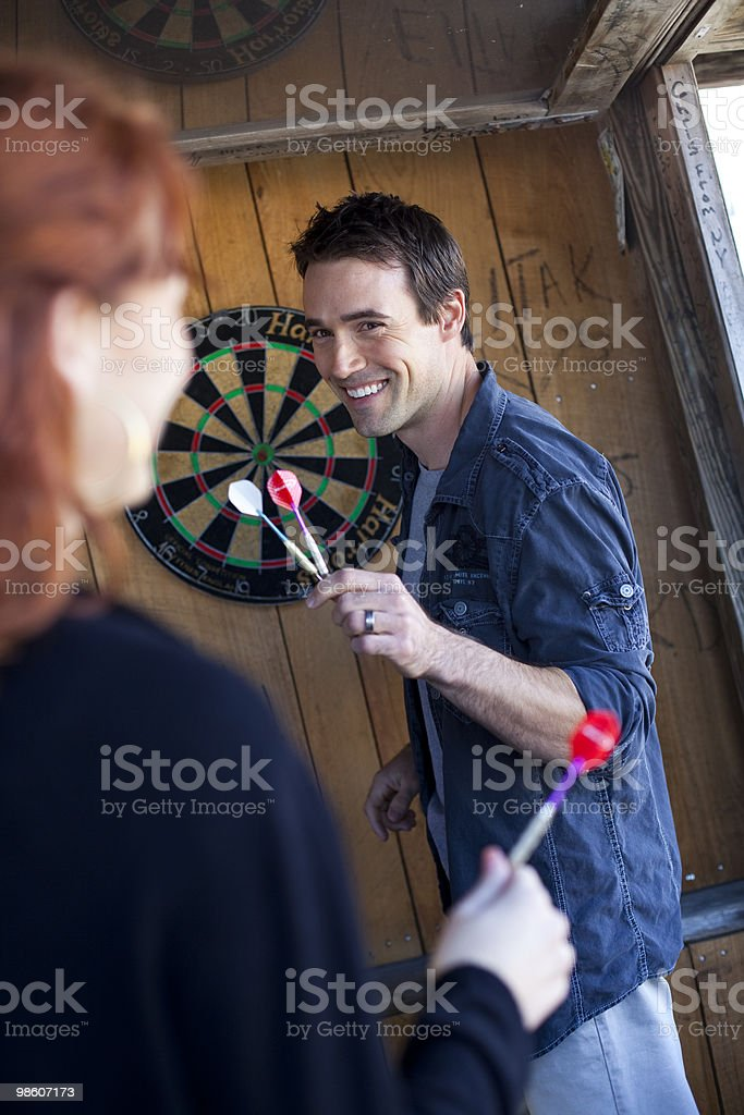 couple playing darts  royalty-free stock photo