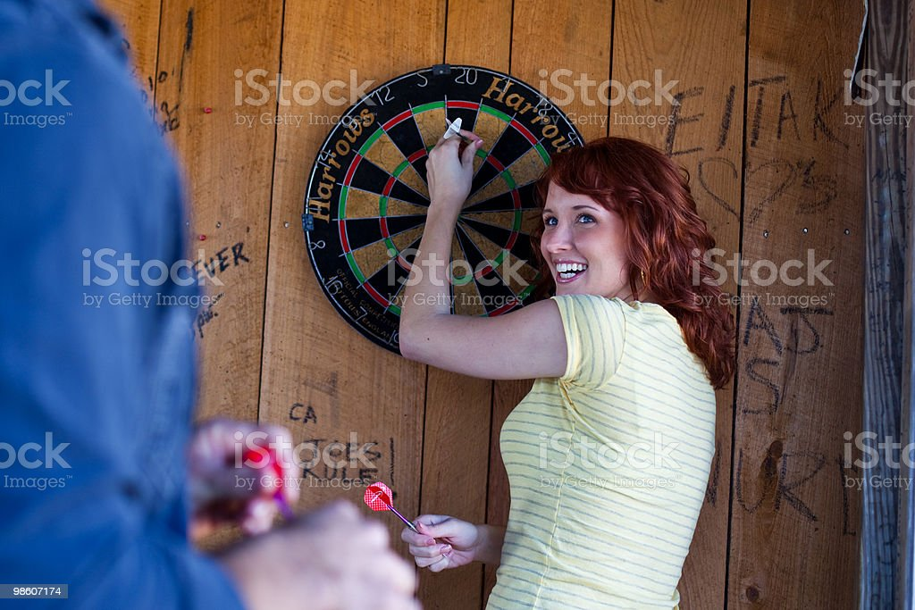 couple playing darts  royalty-free stock photo