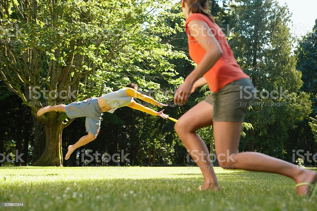 Couple playing frisbee stock photo