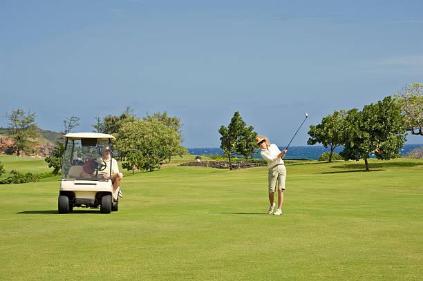 Couple Playing Golf stock photo