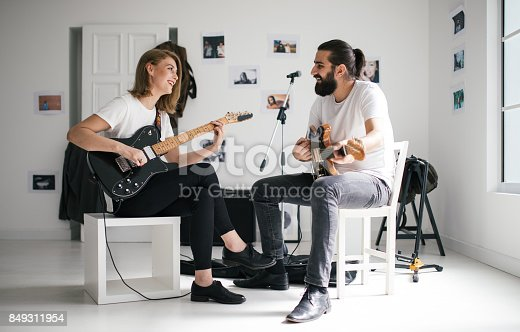 849362192 istock photo Couple playing guitars 849311954