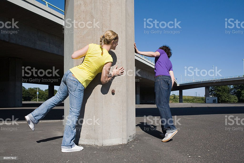 Couple playing hide and seek royalty-free stock photo