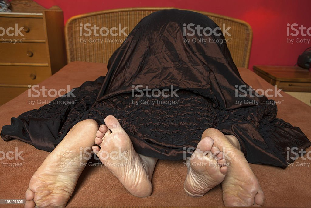 Couple playing in bed stock photo