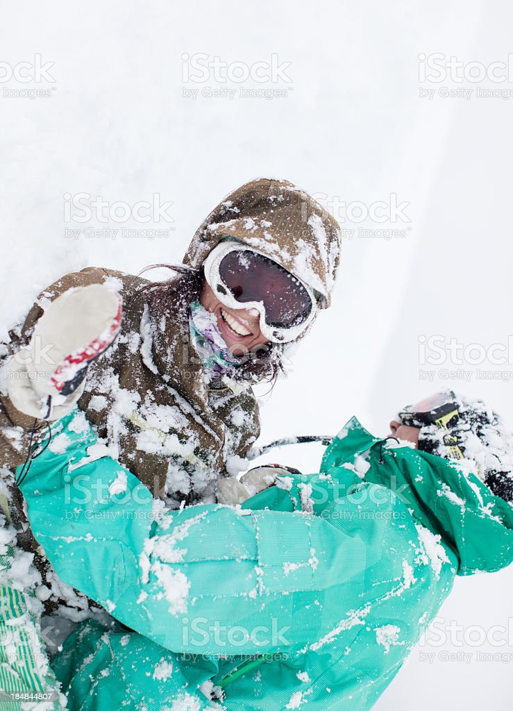 Couple playing in snow royalty-free stock photo