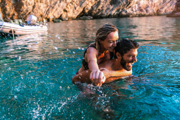 Couple playing in tropical sea stock photo
