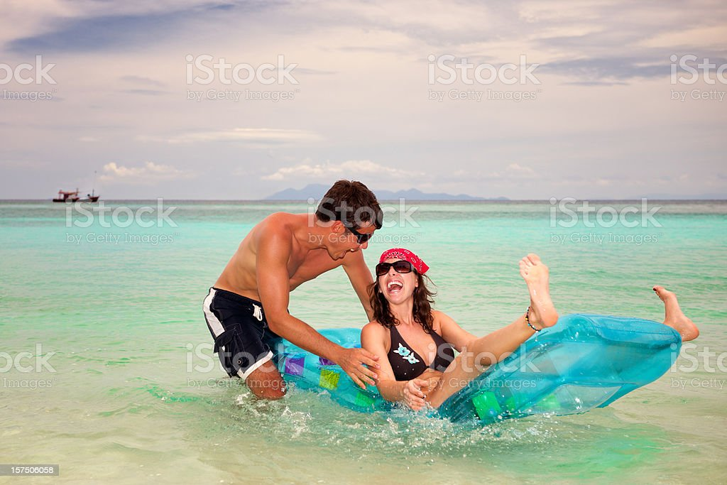 Couple playing on the beach (XXXL) royalty-free stock photo