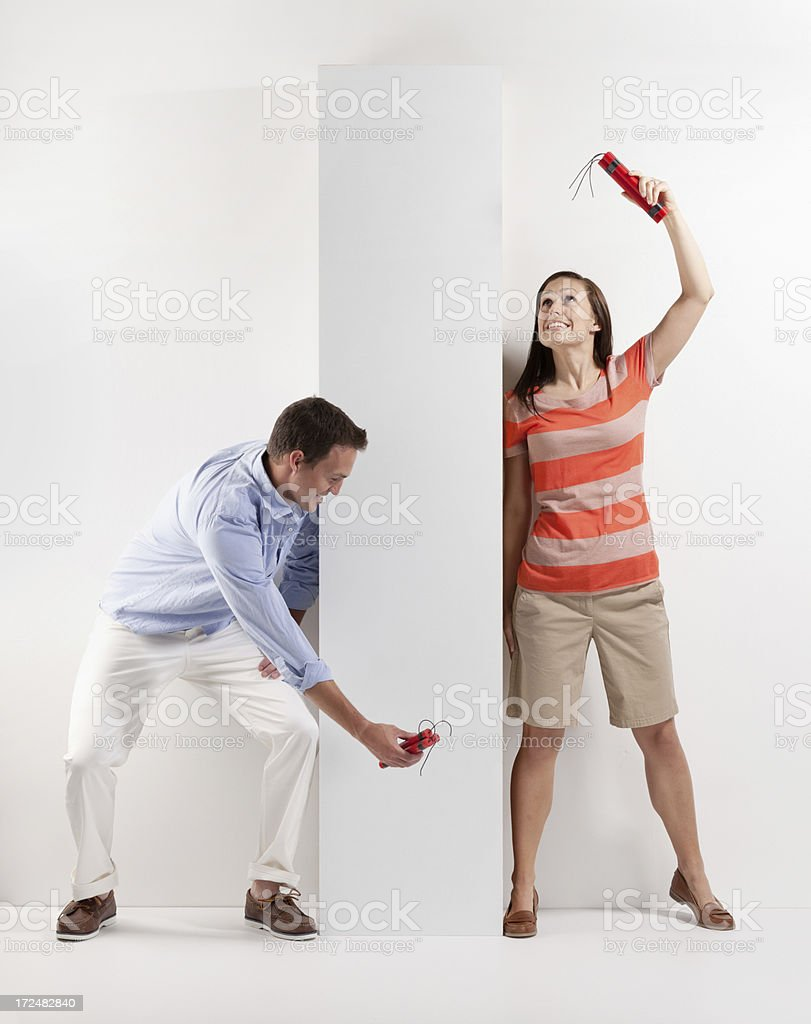 Couple playing pranks on each other with dynamites royalty-free stock photo