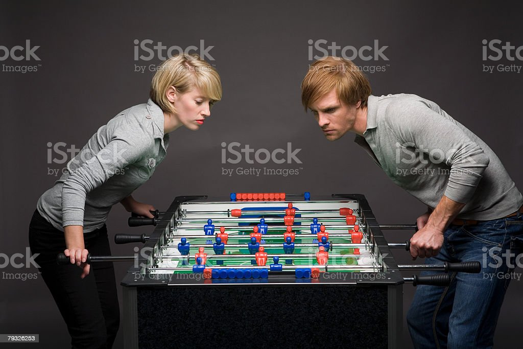Couple playing table football royalty-free 스톡 사진