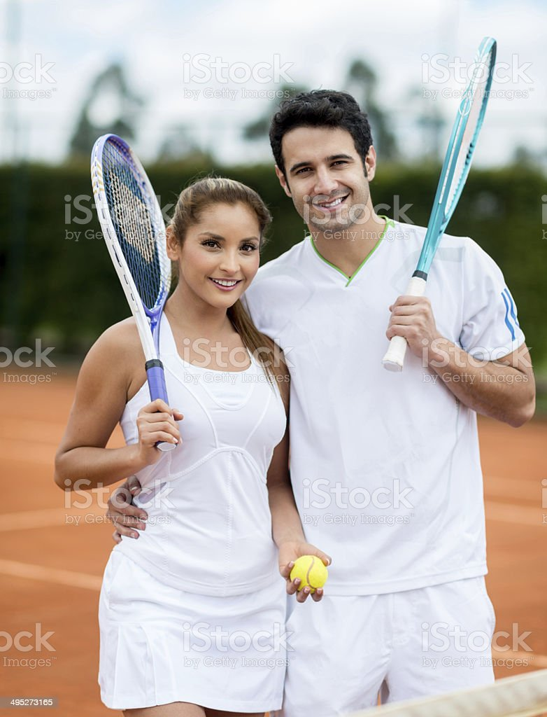 Couple playing tennis stock photo