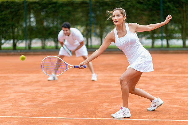 couple playing tennis - tennis stock photos and pictures