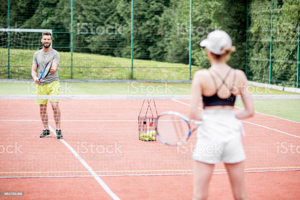 Couple playing tennis royalty-free stock photo